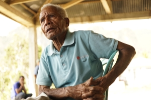 96 year old man tells stories of the changes he has seen in his village in Timor Leste. He talked about the difference in democracy and the leadership of past countries. He focused on the fact that although freedom is good people often fear the responsibility it brings.